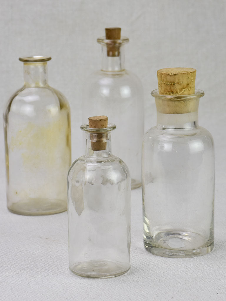 Collection of four small pharmacy flasks - 19th century blown glass