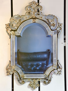 Antique Venetian mirror with decorative frame