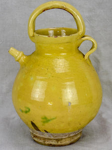Antique French water pitcher with pale yellow glaze