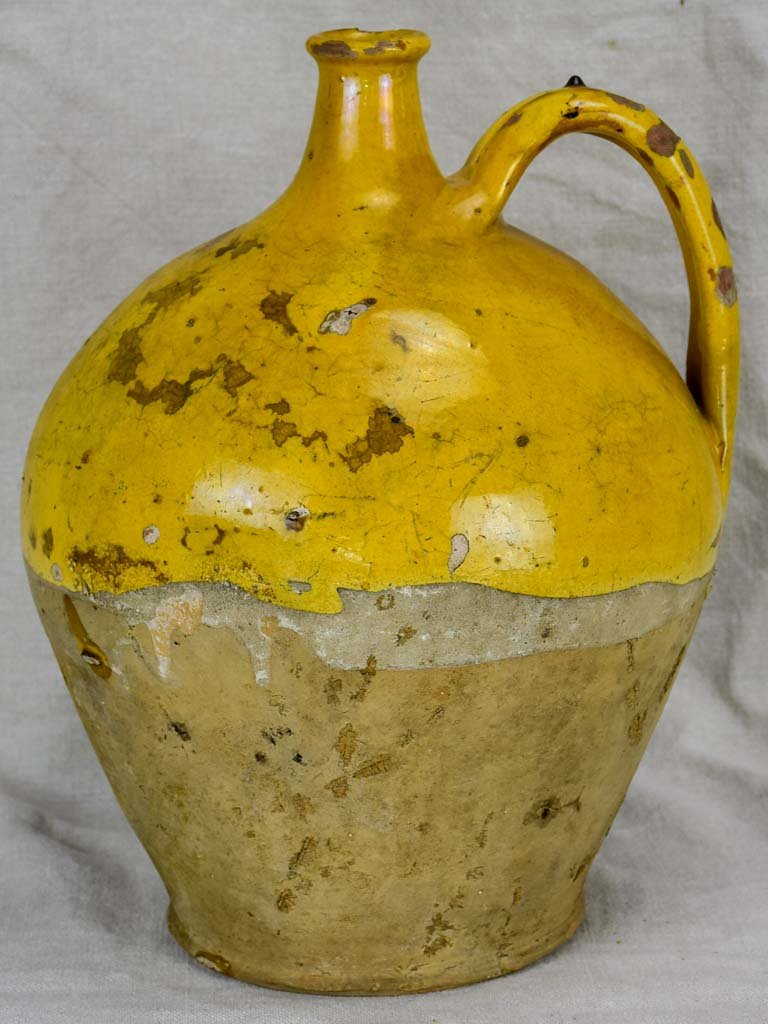 19th Century French water pitcher with yellow glaze