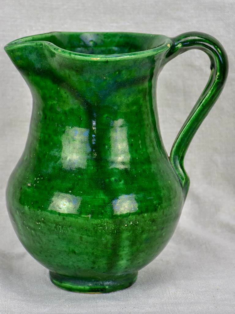 Antique French water pitcher with green glaze