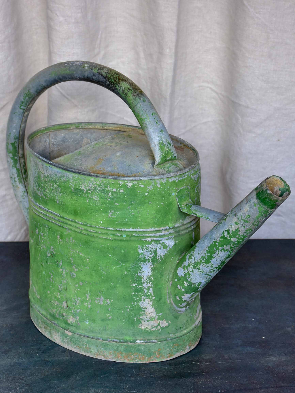 Early 20th Century watering can with green patina