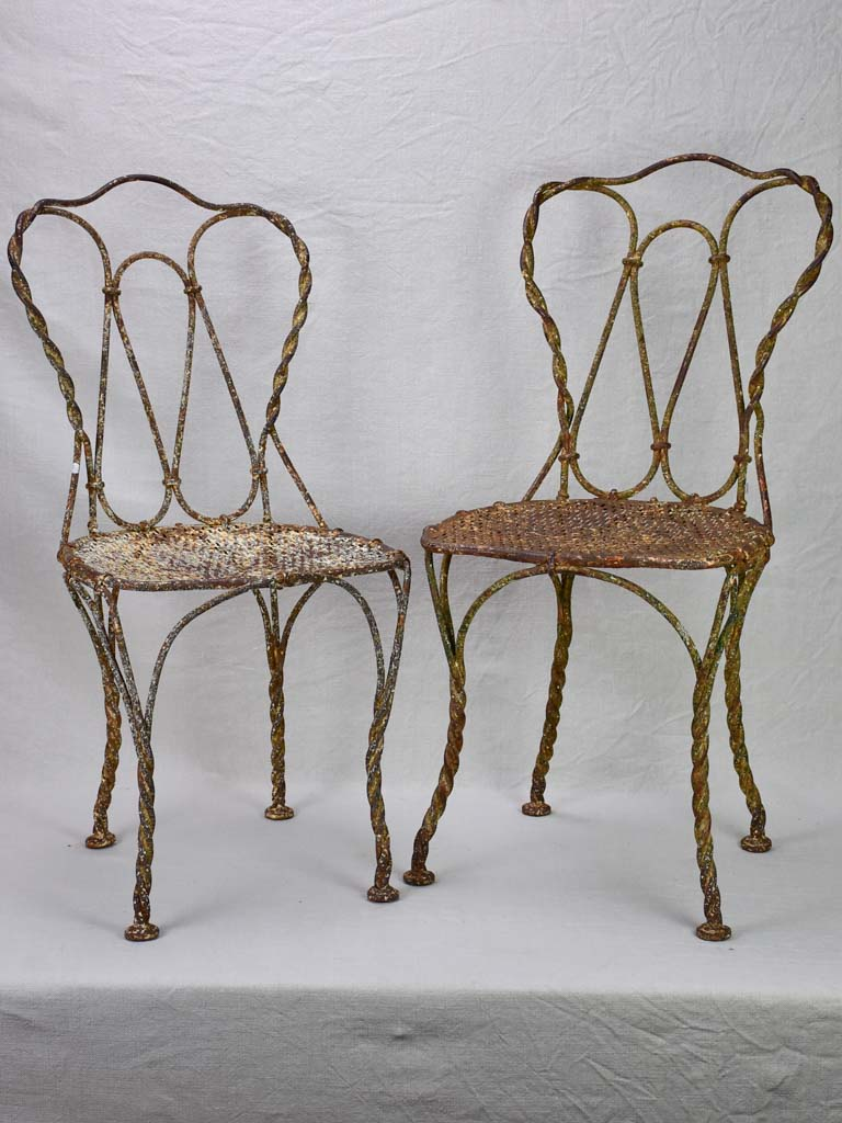 Pair of pretty 19th century French garden chairs with twisted iron frames