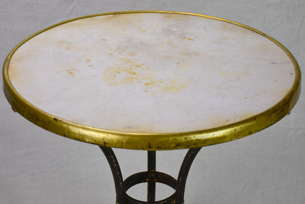 Marble top bistro table with iron base from the 1900's
