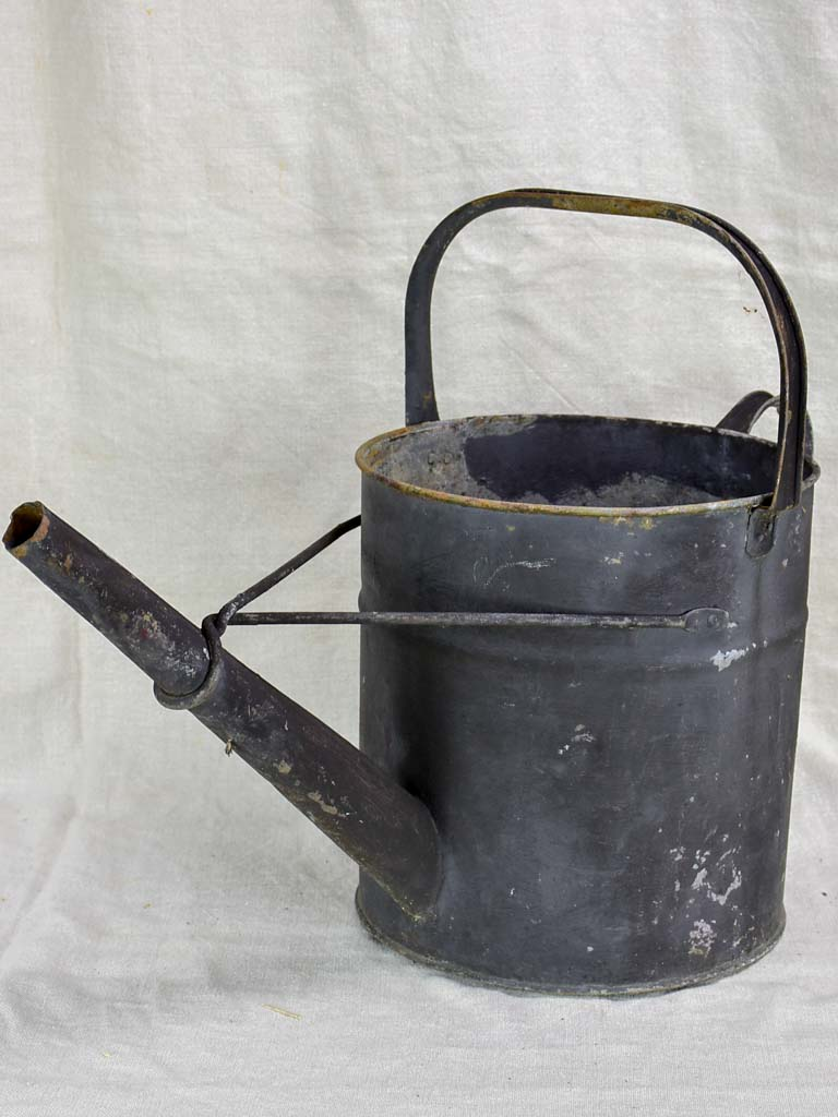 Antique English watering can with black painted finish