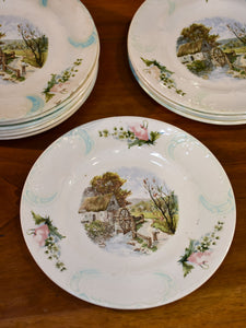 11 French faïence earthernware plates with country scene