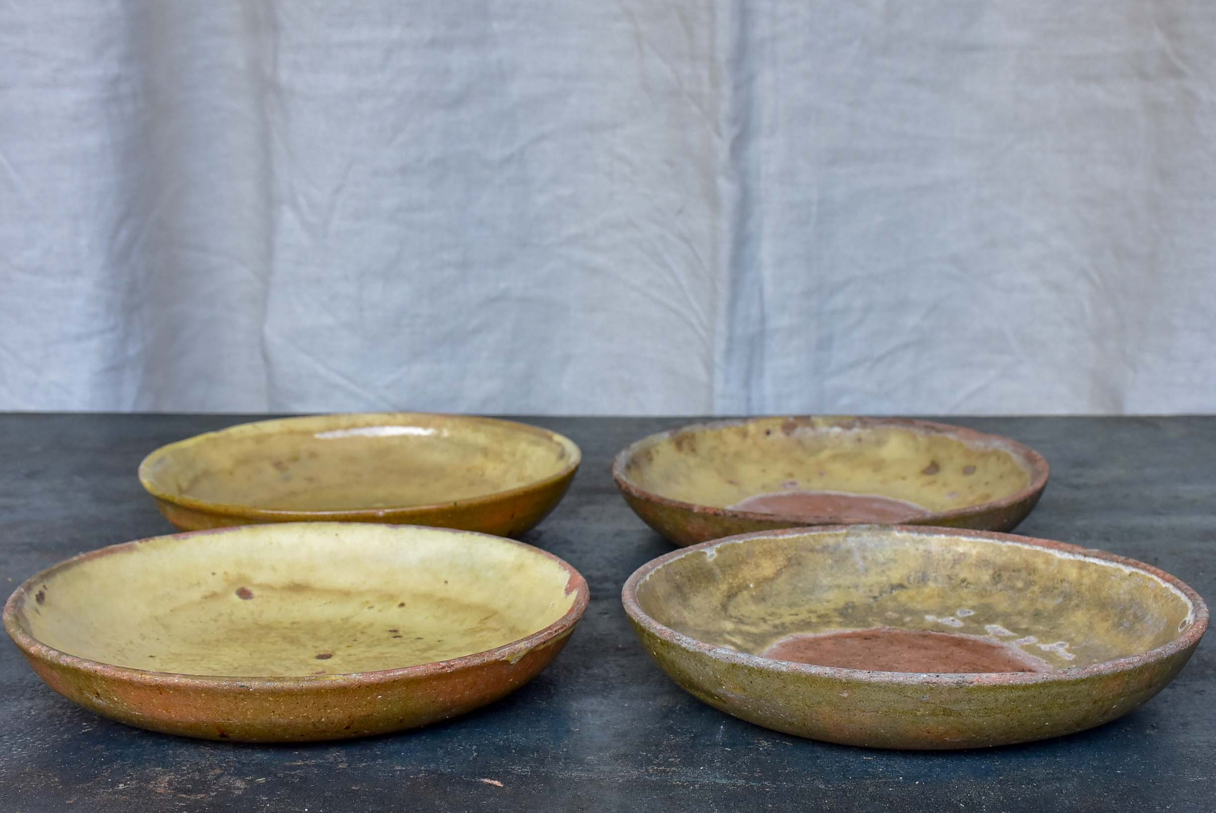 Four rustic French terracotta plates