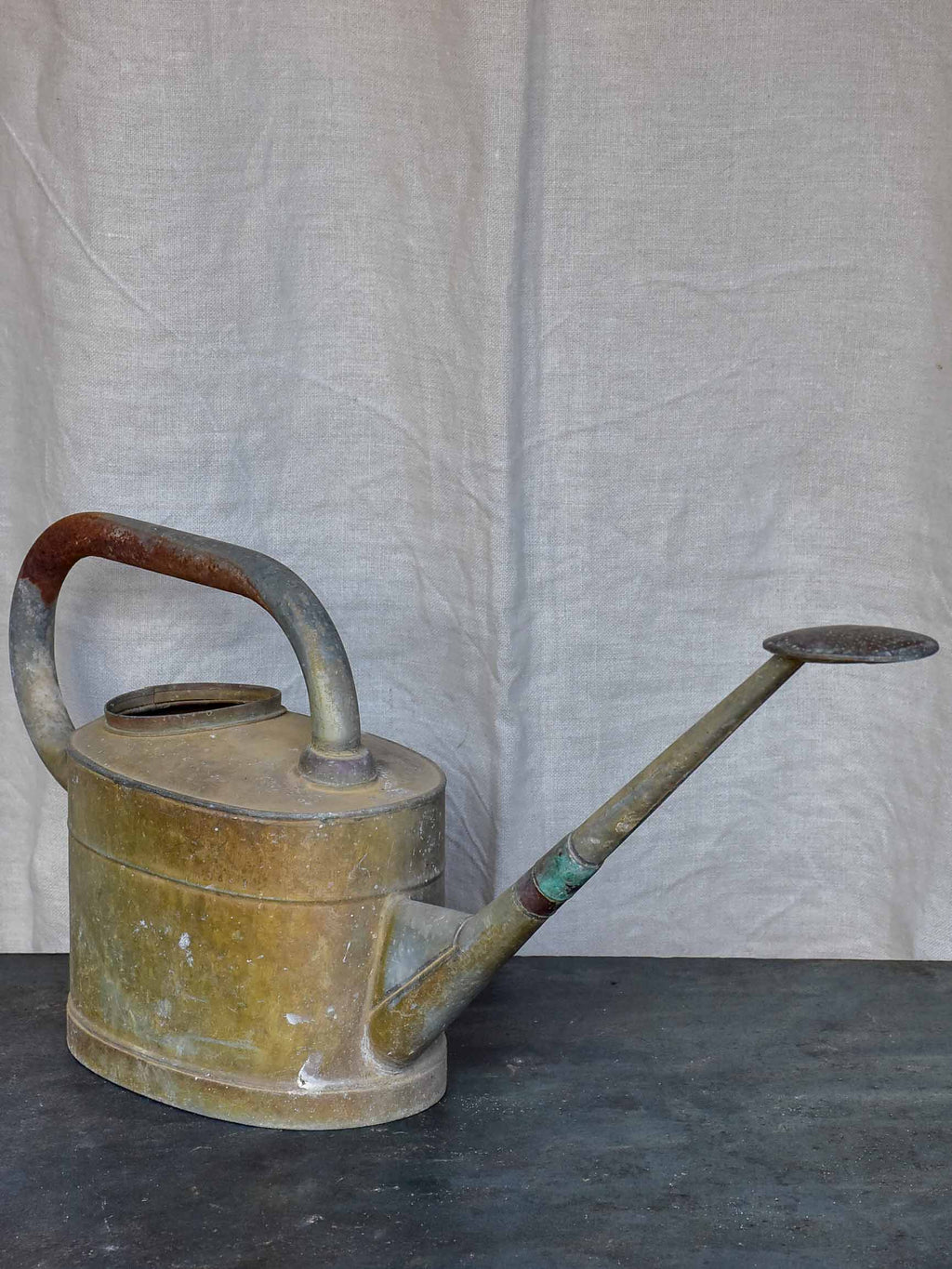 Antique French watering can with long spout