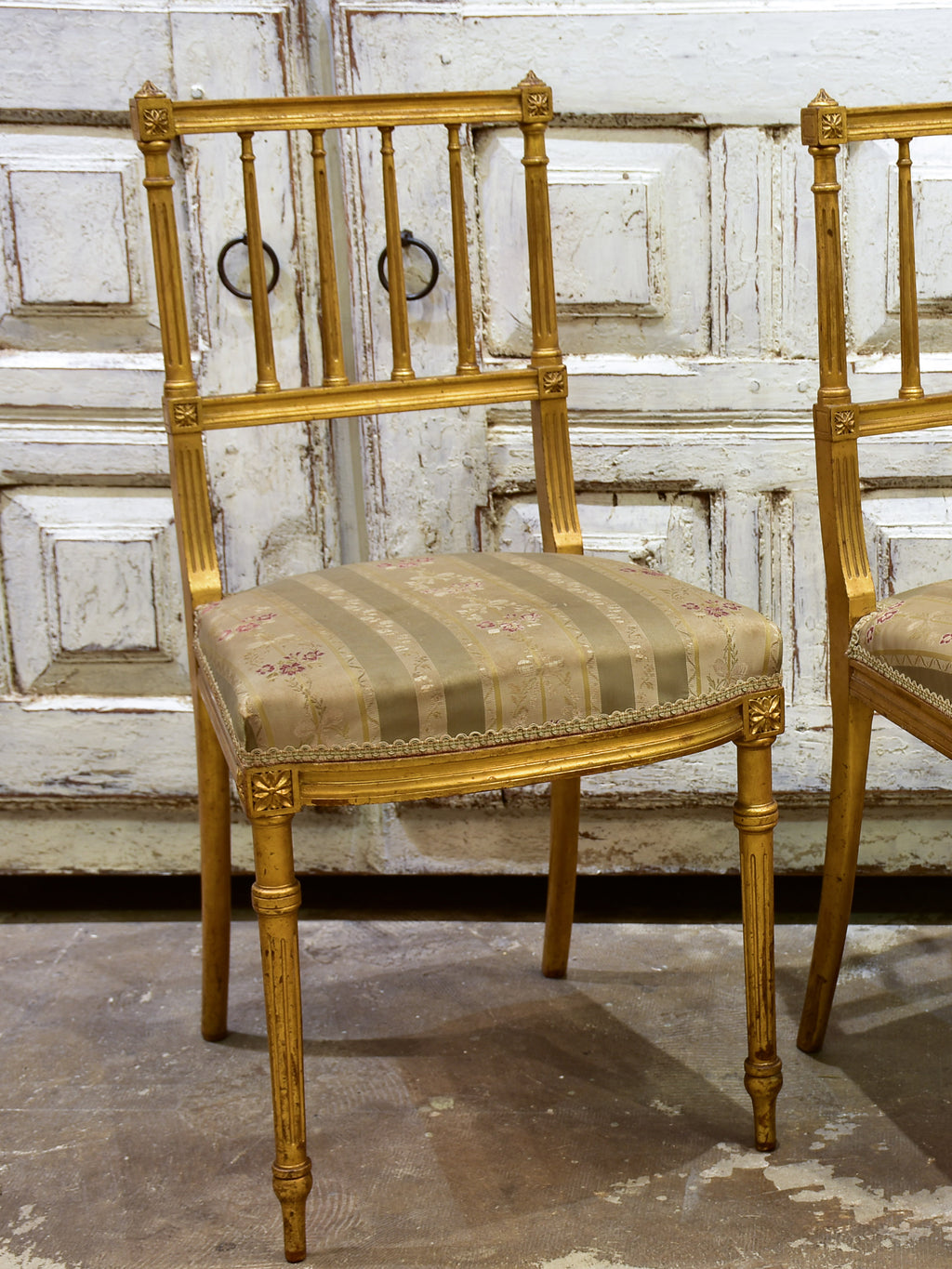 Pair of Louis XVI style gilded chairs