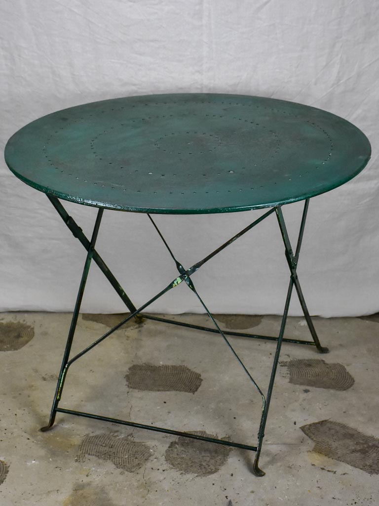 Round antique French folding garden table with green paint finish