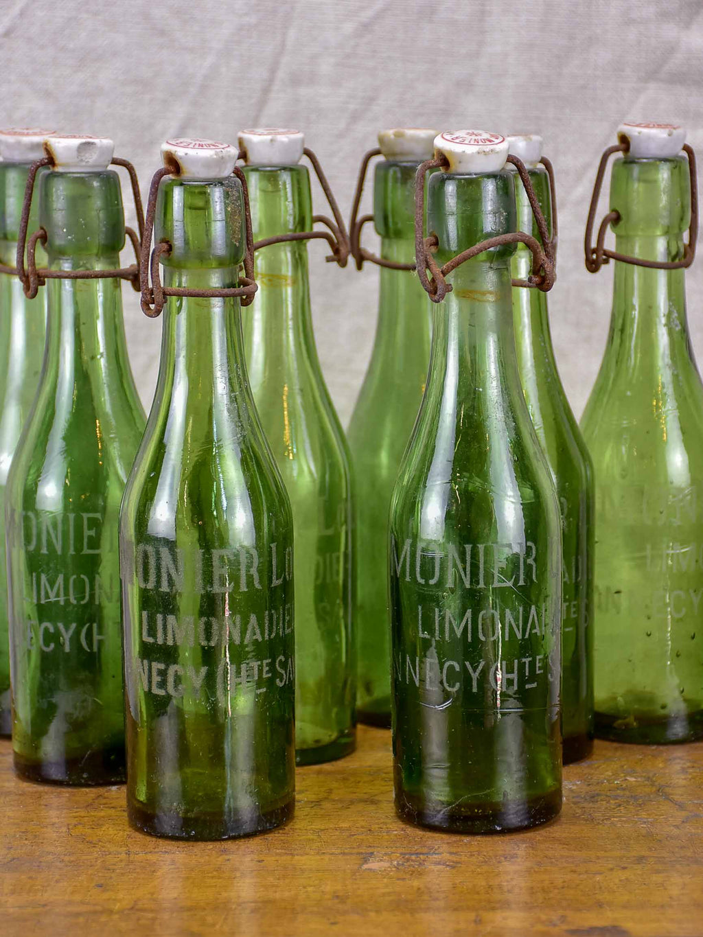 17 antique French lemonade bottles with ceramic stoppers