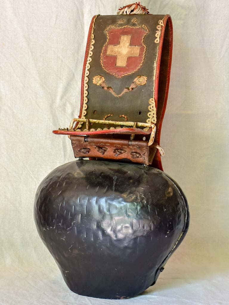 Antique Swisse cowbell with leather strap