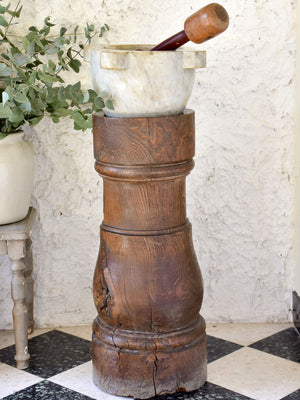 Marble mortar with double headed pestle in carved timber stand