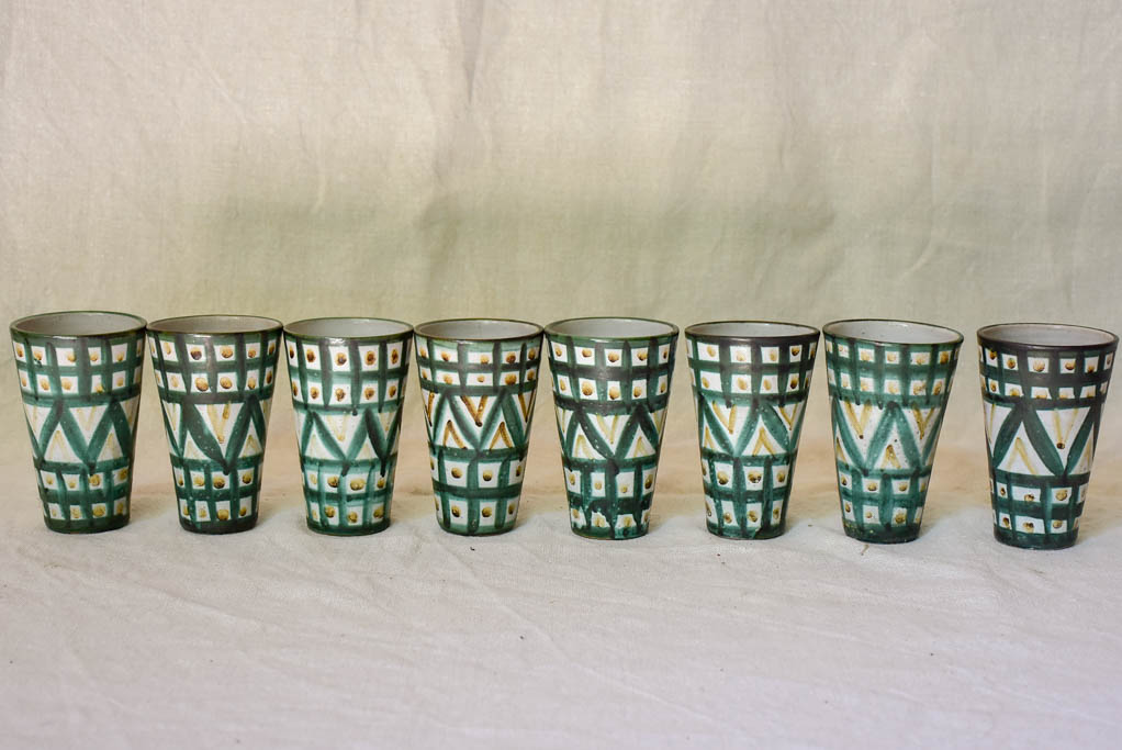 Eight mid century French ceramic Robert Picault juice cups and pitcher
