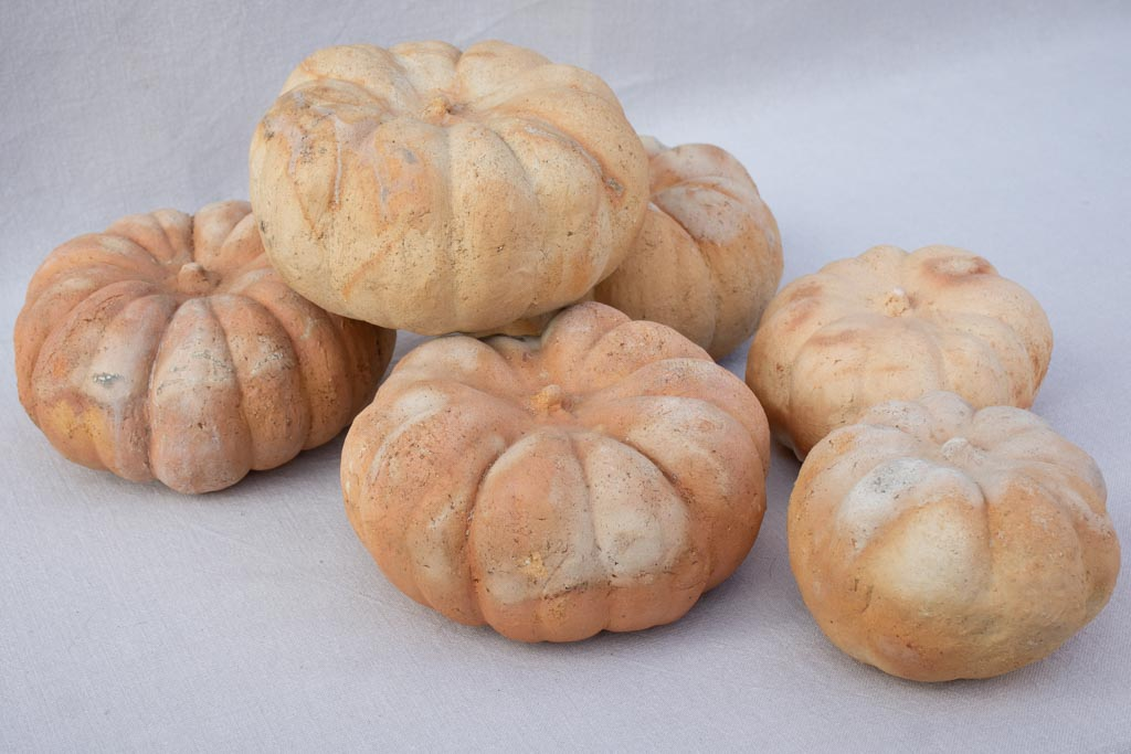 Collection of six terracotta pumpkin decorations