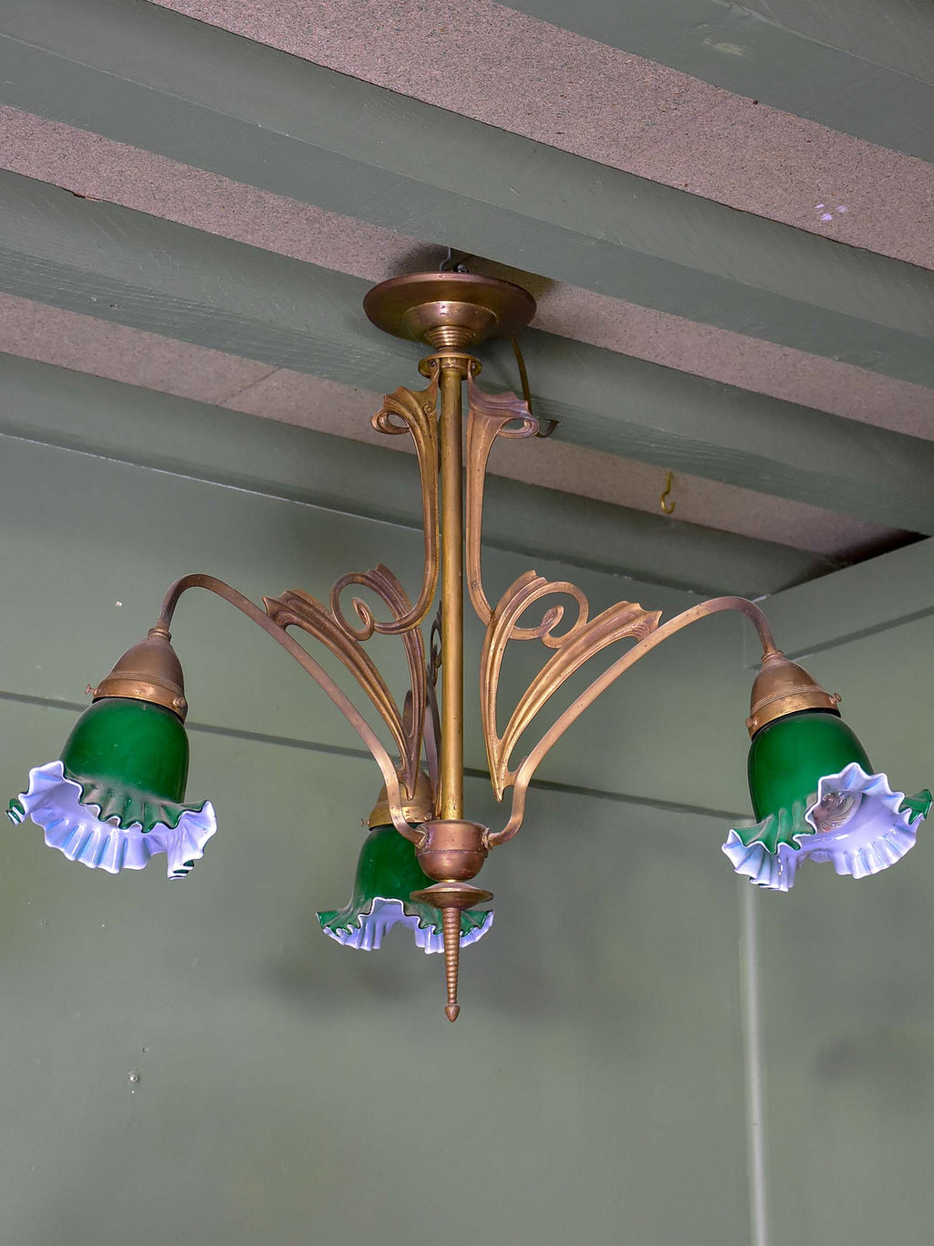 French Art Nouveau three light pendant with green glass lampshades