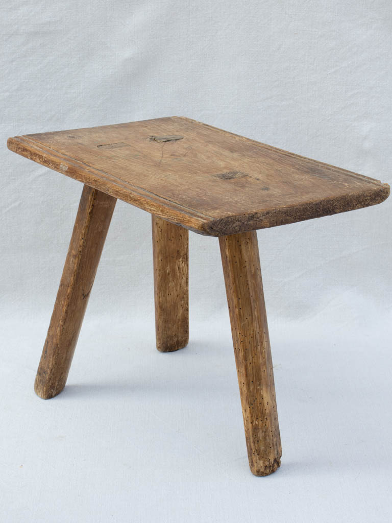 Primitive milking stool with three legs