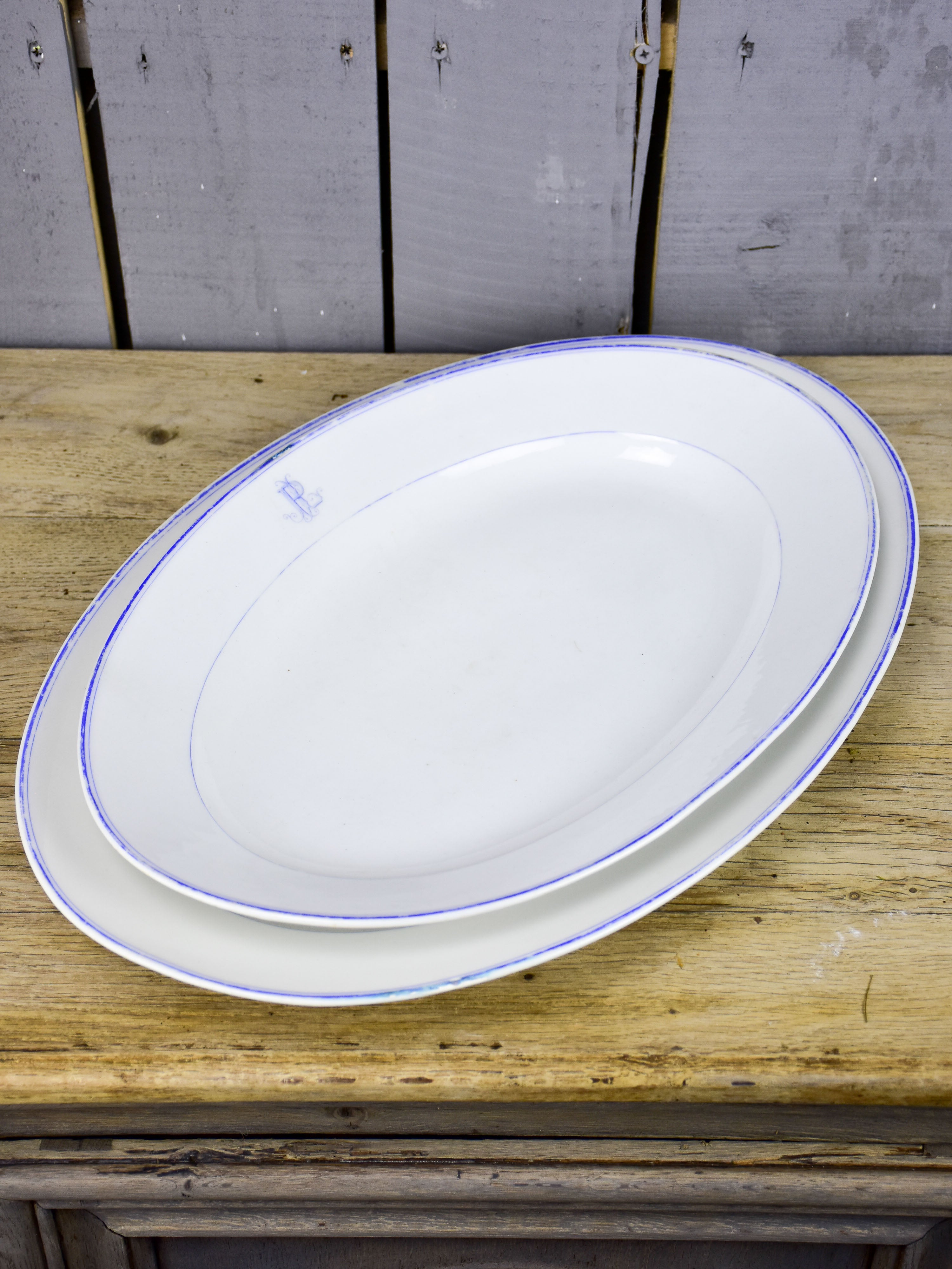 Two faïence platters with PL monogram