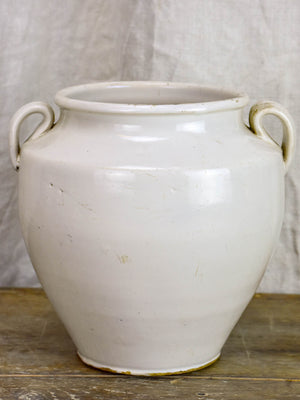 Antique earthenware preserving pot with white glaze