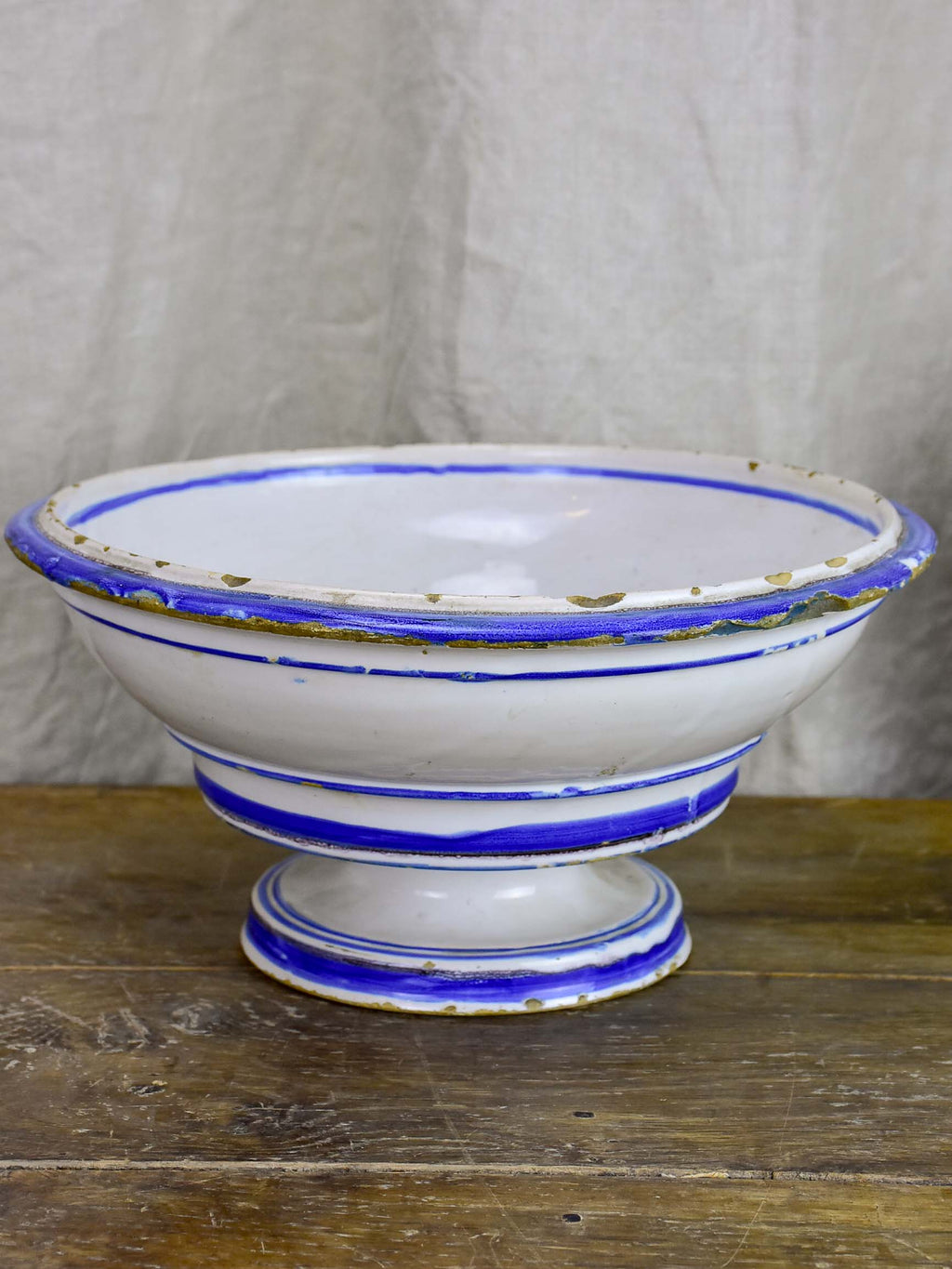 Antique fruit bowl with blue and white glaze