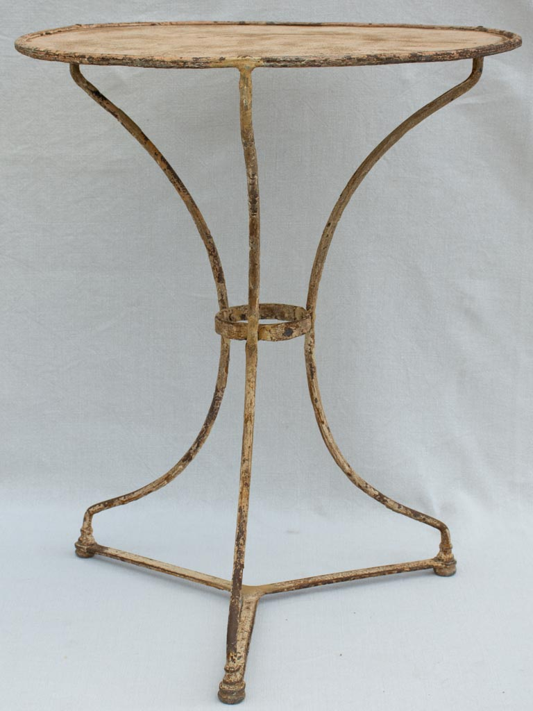 Early 20th century French garden table with ochre patina