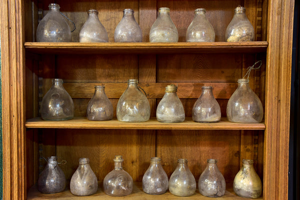 Collection of 16 antique French fly trap bottles