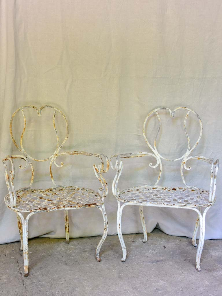 Pair of whimsical French garden armchairs