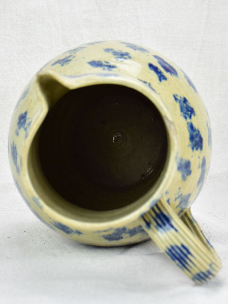 Rustic French pitcher with blue spots