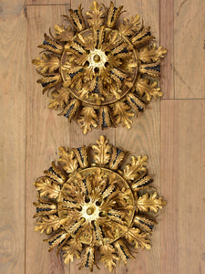 Pair of Maison Charles wall sconces / ceiling lights with gold leaves
