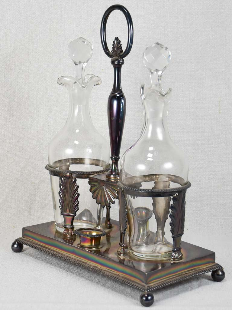 Two crystal carafes in a silver carrier