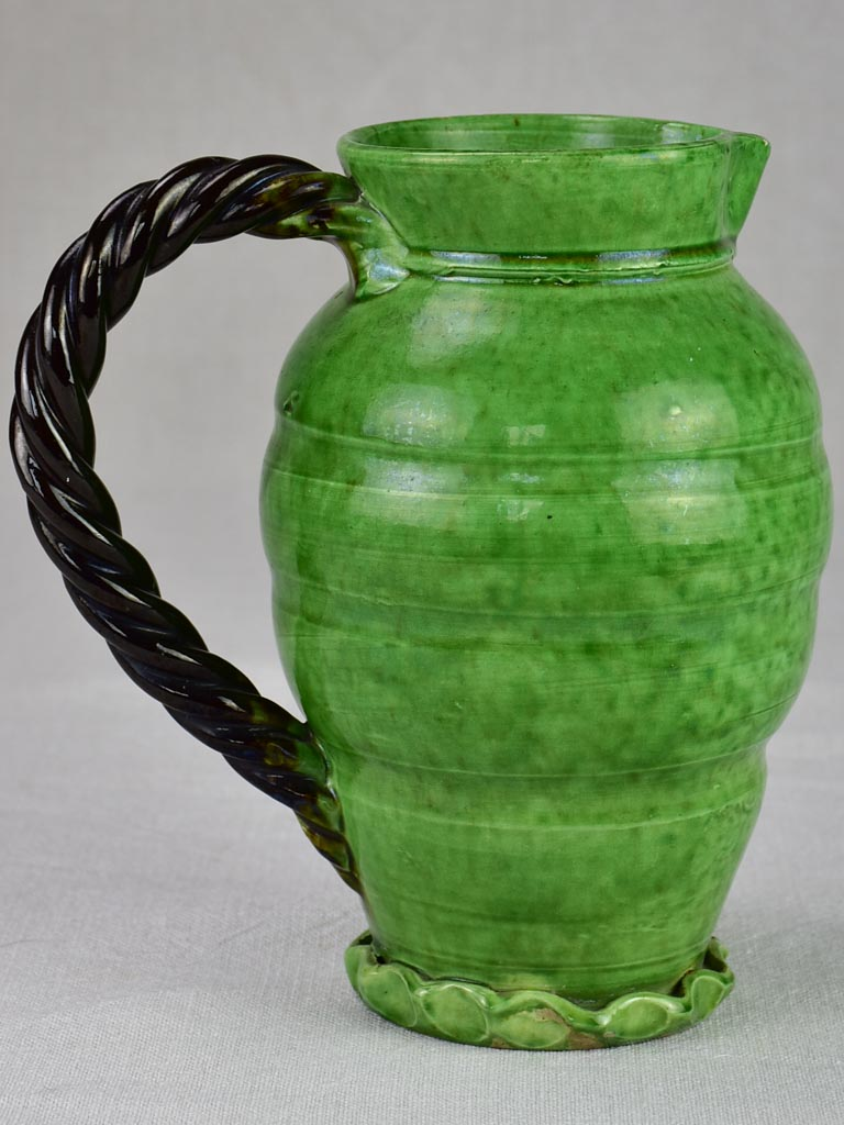 RESERVED Mid century pitcher from Vallauris with green glaze and twisted handle 8¾""