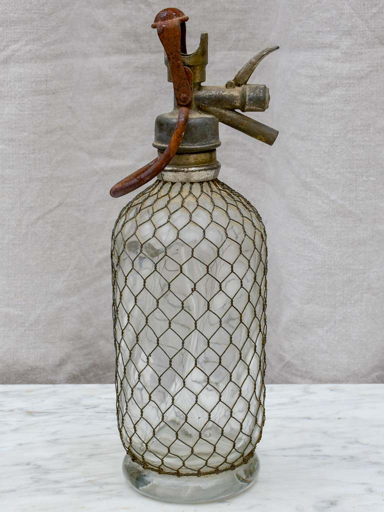 Early 20th Century French seltzer bottle with mesh
