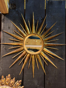Vintage sunburst mirror with gilded metal frame