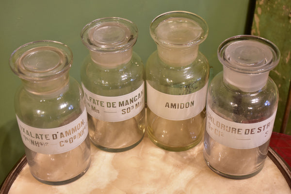 Four antique French apothecary glass jars