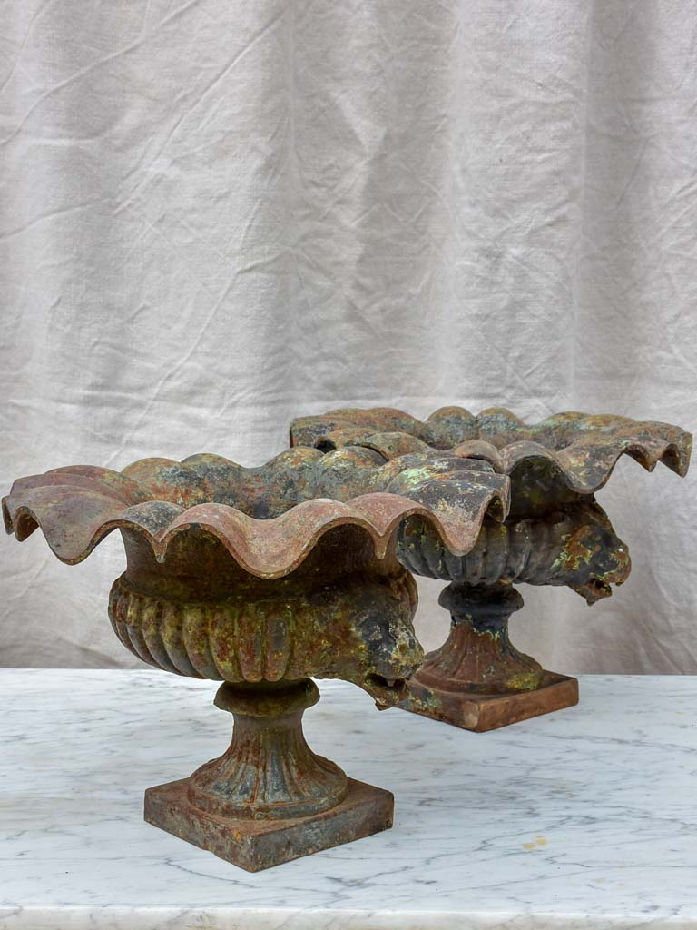 Pair of 19th Century cast iron Medici urns with lion's heads