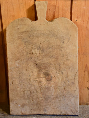 Antique French cutting board with rounded shoulders