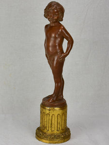 Eary 20th Century French terracotta sculpture of a boy on a gilded column - signed