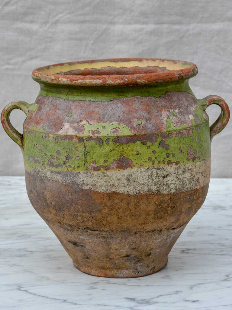 Rustic antique French confit pot with pale green glaze