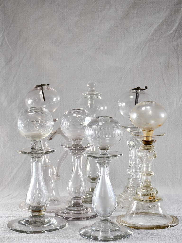 Rare collection of seven blown glass oil lamps - 18th and 19th century