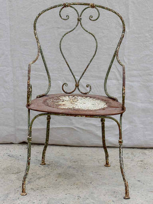 Antique French garden armchair with perforated seat and green patina