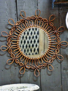 Round vintage mirror with cane frame