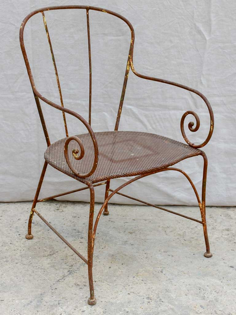 Antique French garden armchair with bar backrest and perforated seat