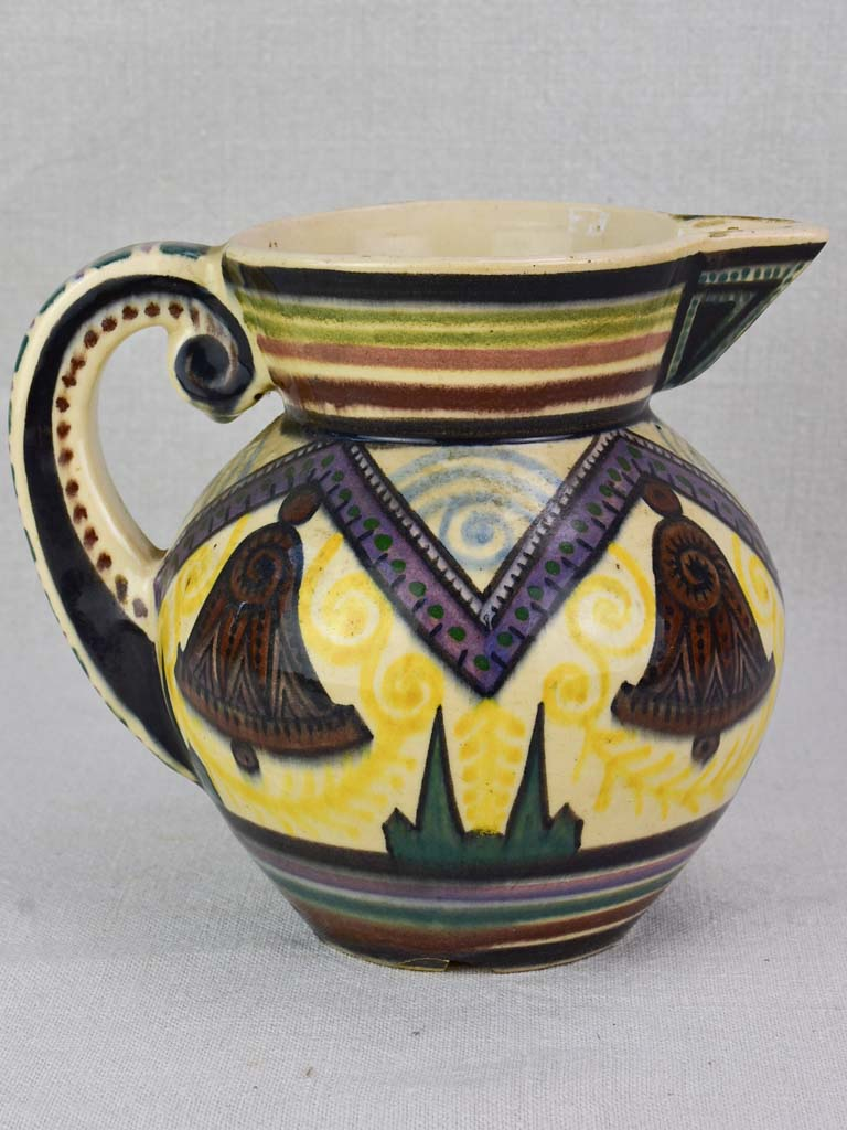 Mid-century Quimper pitcher decorated with bells and trees