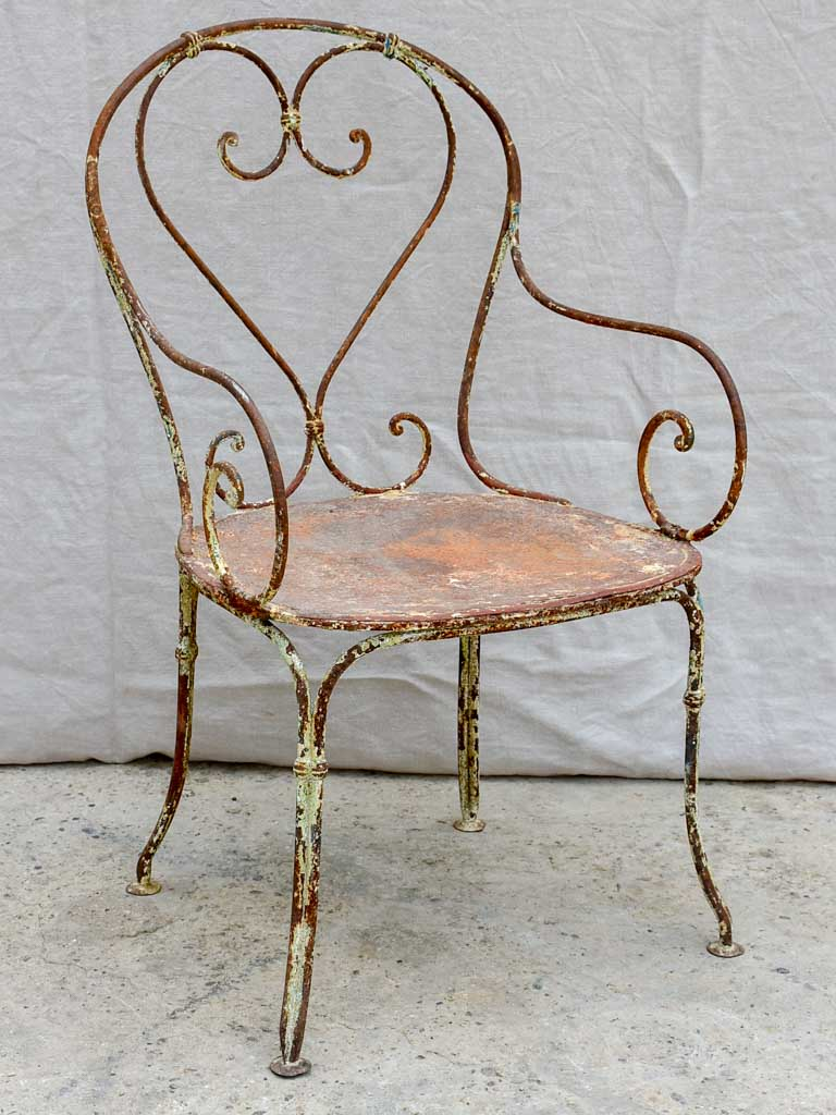 Antique French garden armchair with heart back and solid seat