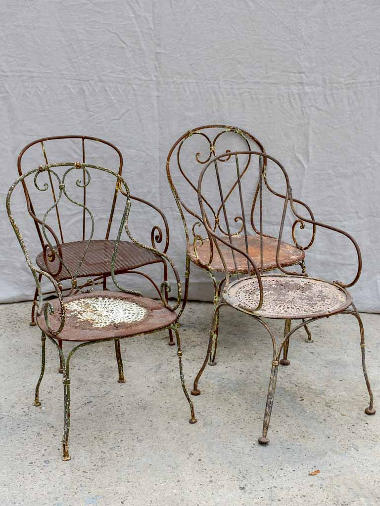 Collection of four antique French garden armchairs