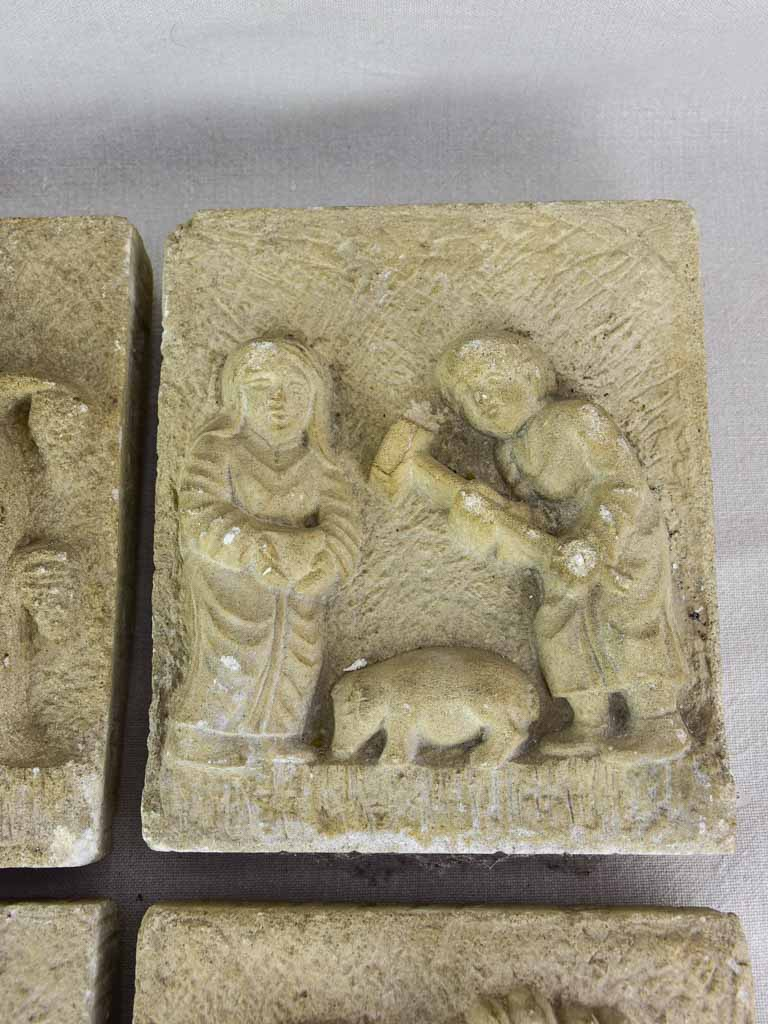 "Four antique French carved stone sculptures decorated with country scenes 9½"" x 8"""