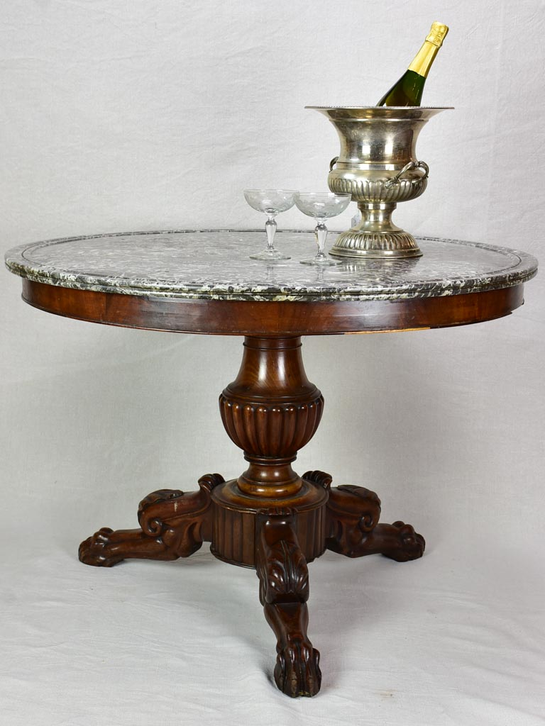 Early twentieth-century Napoleon III round center table with black marble top and claw feet 38¼""