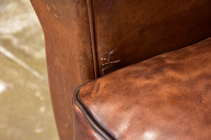 Pair of vintage French brown leather club chairs