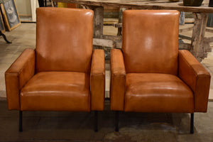 Pair of French leather armchairs in the style of Pierre Guariche