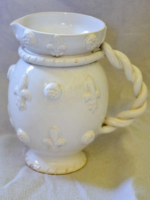 1960's Émile Tessier white ceramic pitcher with fleur de lys